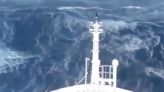 Ship slammed by monster waves in violent mega storm at sea